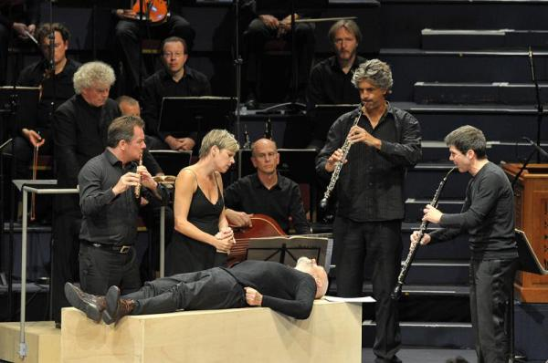 Camilla Tilling and Mark Padmore with members of the Berlin Philharmonic in Peter Sellars' staging of the St Matthew Passion